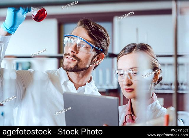 Scientists in the lab obtaining experimental data working diligently