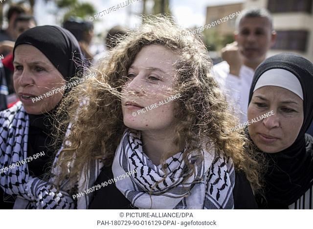 Palestinian activist Ahed Tamimi (C) arrives for a press conference, with her mother Nariman (R), after her release from an Israeli prison where she served a...