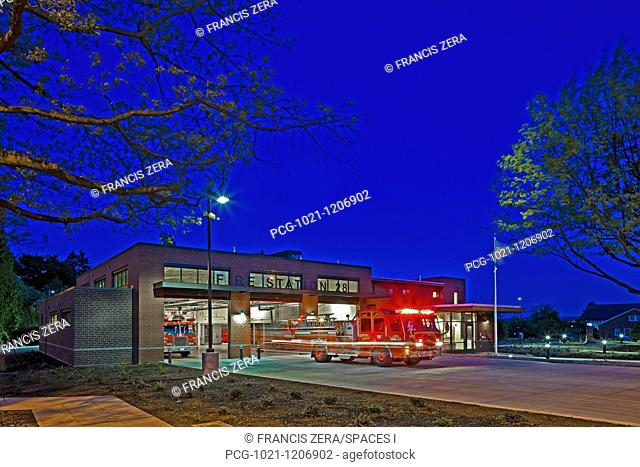 Fire Engine Leaving a Station at Night