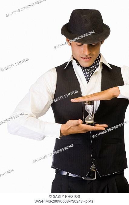 Businessman holding an hourglass