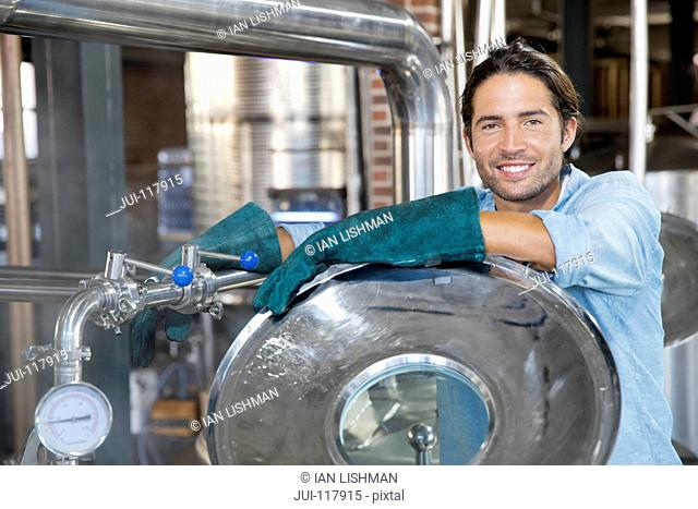 Portrait Of Male Brewery Worker Checking Fermentation Process