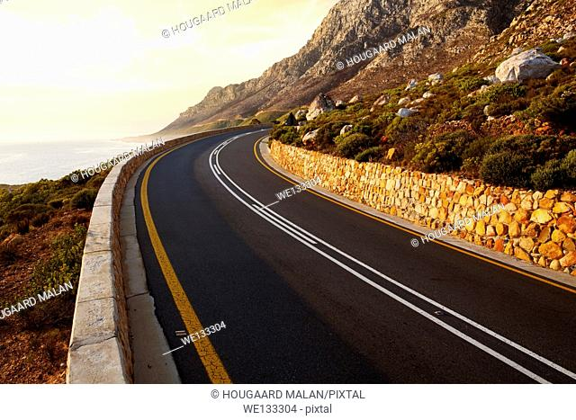 Lanscape photo of the Clarence Drive seaside mountain pass on a sunny day. Western Cape, South Africa