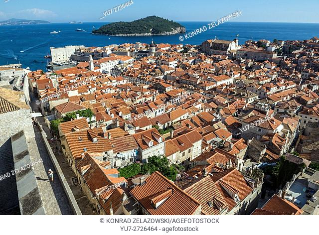 View from defensive Walls of Dubrovnik, Old Town of Dubrovnik city, Croatia, with Saint John Fortress on left and Lokrum Island