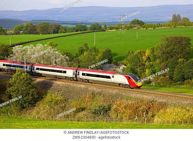 Class 390 Pendolino Virgin train passing Strickland Mill, Great Strickland, Cumbria, West Coast Main Line, England, UK