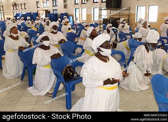 Christian faithful wearing face mask and maintaining social distancing gather to make praises to God at Lagos Presbyterian church