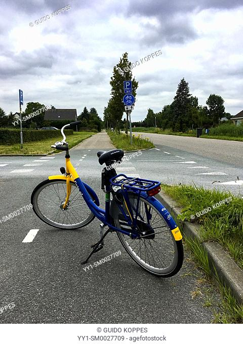 Barendrecht, Netherlands. Public Transportation Rental Bike on a Bike Road between a local Railway Station and a Sauna