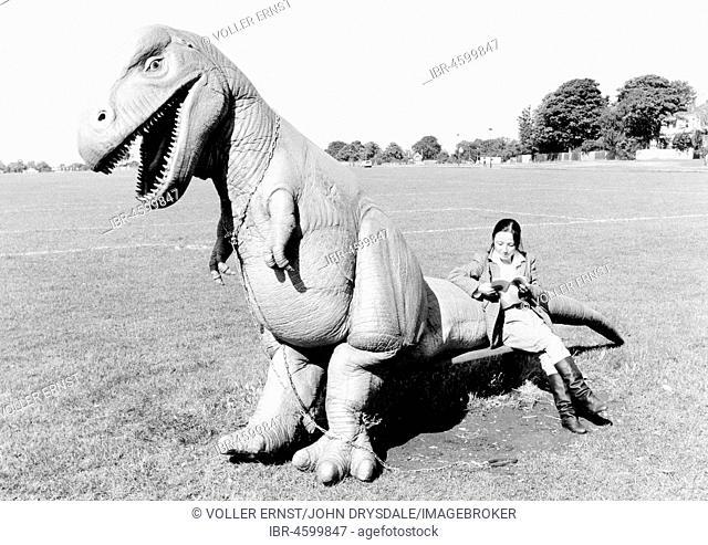Woman sitting on Dino, England, Great Britain