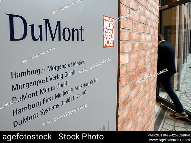 """10 January 2020, Hamburg: A man walks into the office building where the daily newspaper """"""""Hamburger Morgenpost"""""""" has its editorial offices"""