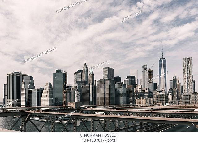 Manhattan skyline seen from Brooklyn Bridge, New York City, New York, USA