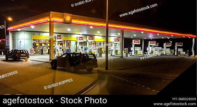 Noord-Brabant, Netherlands. Gas & Fuel Station Alonside Highway at Night
