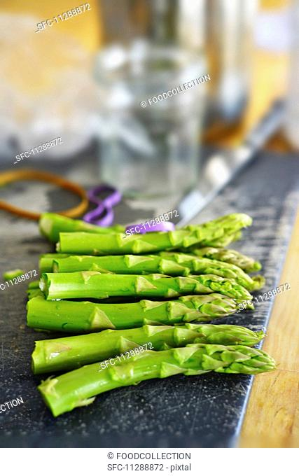 Green asparagus, woody ends cut off