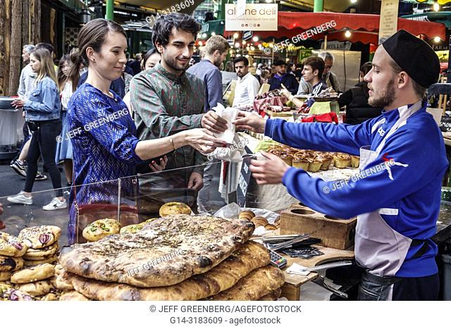 England, London, South Bank Southwark, Borough Market, vendors stalls, bakery, artisanal bread, loaves, Asian, woman, man, buying, selling, display sale