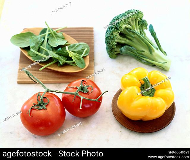 Vegetable Still Life with Vine Ripened Tomatoes, a Yellow Bell Pepper, Broccoli and Arugula