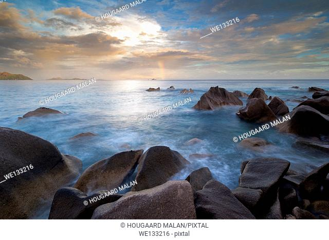 Landscape view of a cloudy sunset on a tropical island. La Digue island, Seychelles