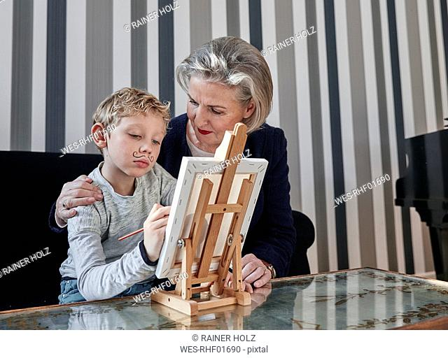 Grandmother and grandson with Dali moustache at easel