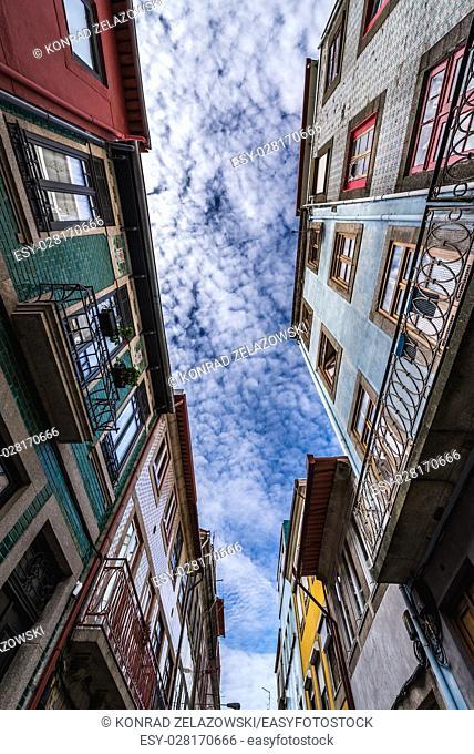 Town houses on a narrow street Rua do Pinheiro (Pine tree Street) in Porto city on Iberian Peninsula, second largest city in Portugal