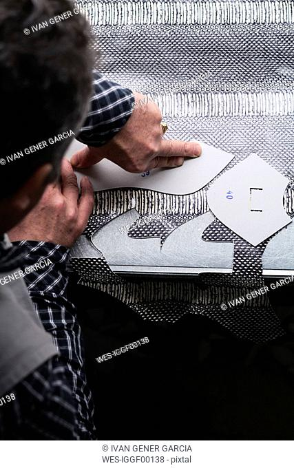 Close-up of shoemaker working on template in his workshop