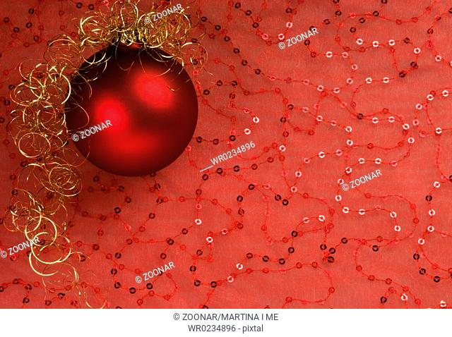 red christmas balls on red fabric