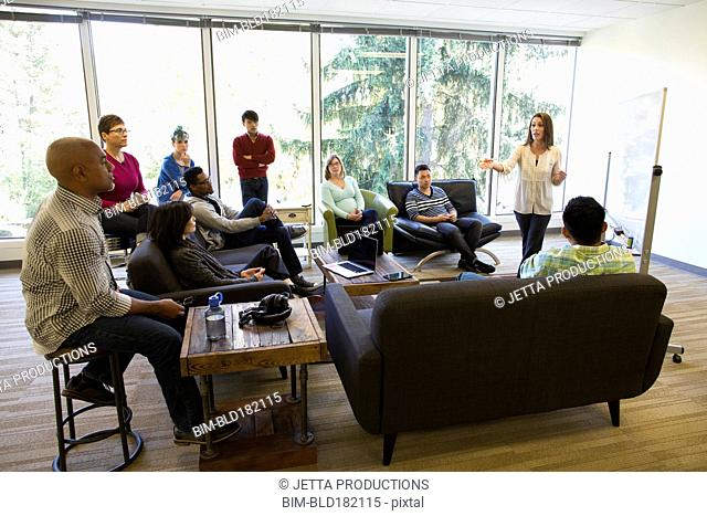 Business people sitting in office meeting