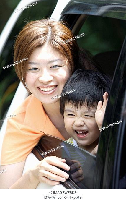 A mother and son in a car