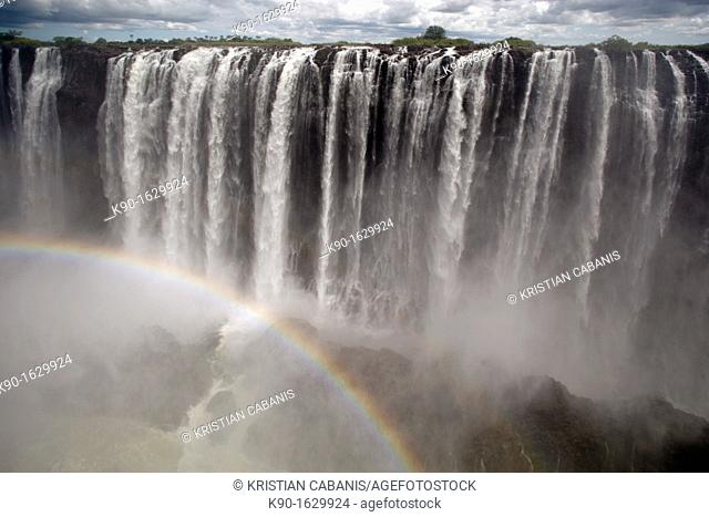 Victoria Falls with clouds and rainbow, Zimbabwe