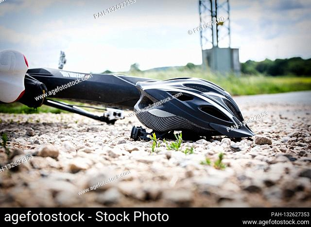 Bamberg, Germany May 26th, 2020: Symbolic images - 2020 bicycle lies on the ground next to it a helmet / cyclist fell / bicycle accident / accident with an...