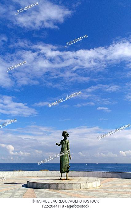Gijón Spain. Monument to the Mother of Migrants on the seafront of the city of Gijón