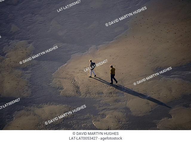 Bleriot plage. Looking down on two people on beach. Shadows. Site des Caps. Pas-de-Calais