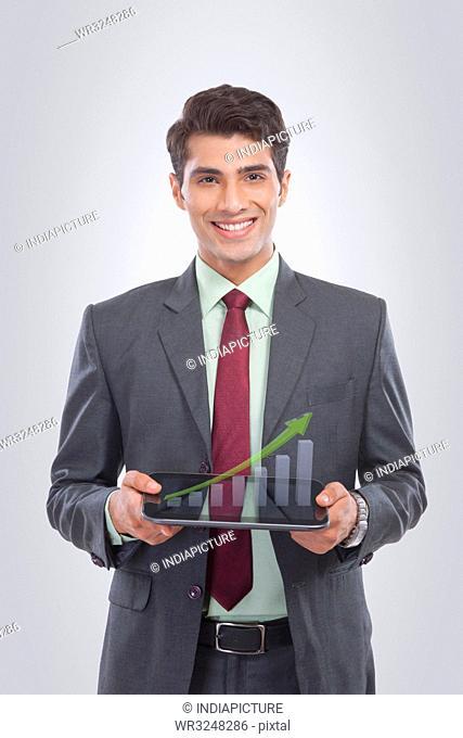 Portrait of businessman holding a digital tablet