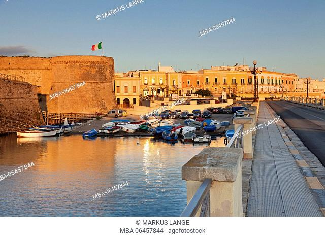 Old Town with fort with sunrise, Gallipoli, province of Lecce, Salento peninsula, Apulia, Italy