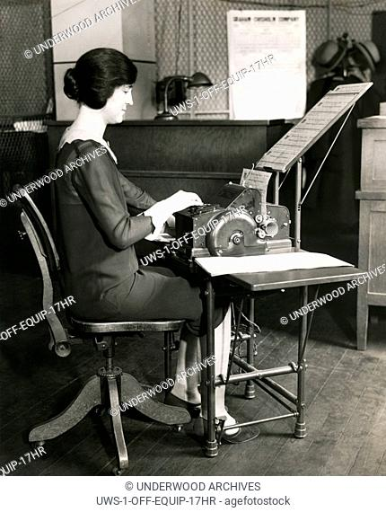 United States: January 4, 1928 A woman worker in an office using a device that processes 1700 documents per hour