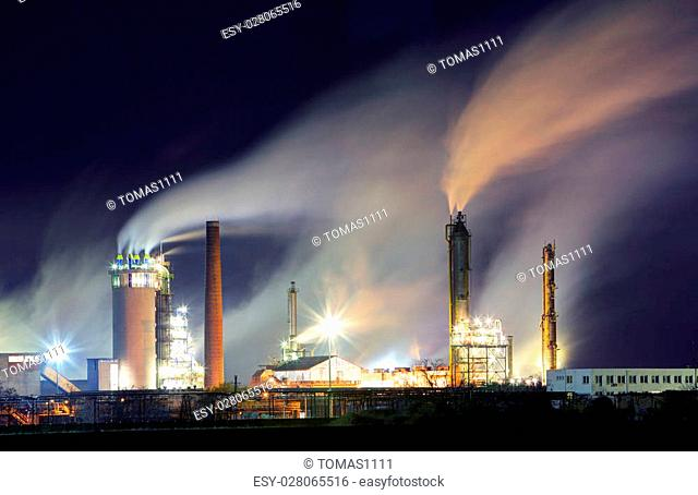 Oil refinery with vapor - petrochemical industry at night