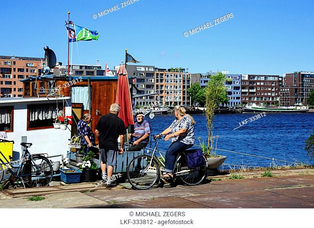 House boat at the Ijhaven canal, Veemkade, at back the island Java-Eiland, Amsterdam, the Netherlands, Europe