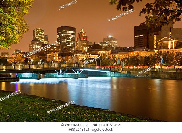 Old port area, Montreal, Quebec, Canada: office buildings, Bonsecours Basin beside St. Lawrence River, night, October