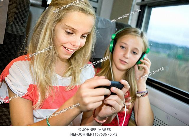 Twin sisters traveling on high speed train