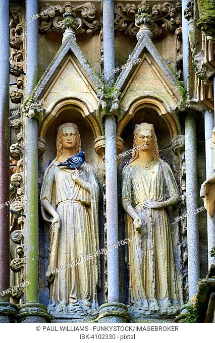 Statues on the facade of the medieval Wells Cathedral built in the Early English Gothic style in 1175, Wells, Somerset, England, United Kingdom