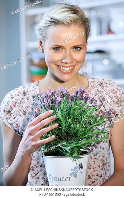 woman with lavender in kitchen