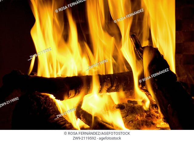 Fire, flames and log in a fireplace, Albacete, Spain