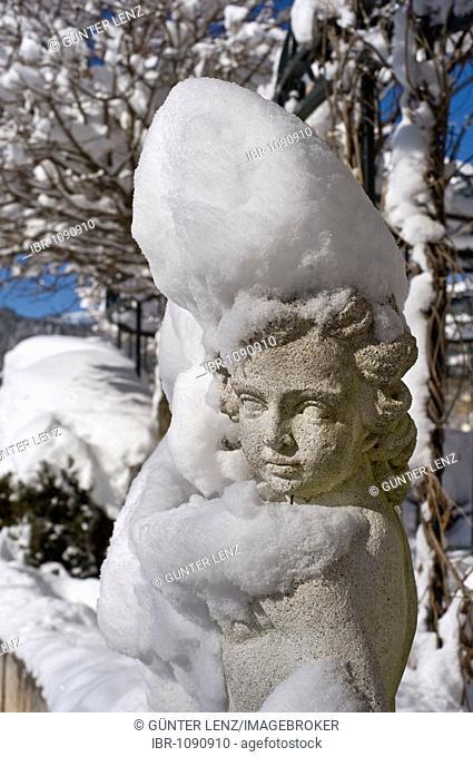 Snow-covered statue of an angel, Achenkirch, Tyrol, Austria