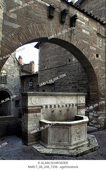 Fountain under an arch, Perugia, Umbria, Italy