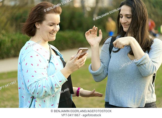 Two friends with smartphone