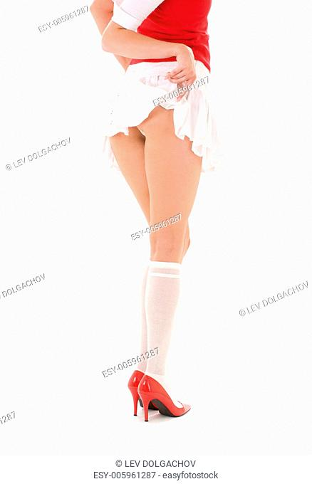 closeup picture of woman pulling skirt up her legs