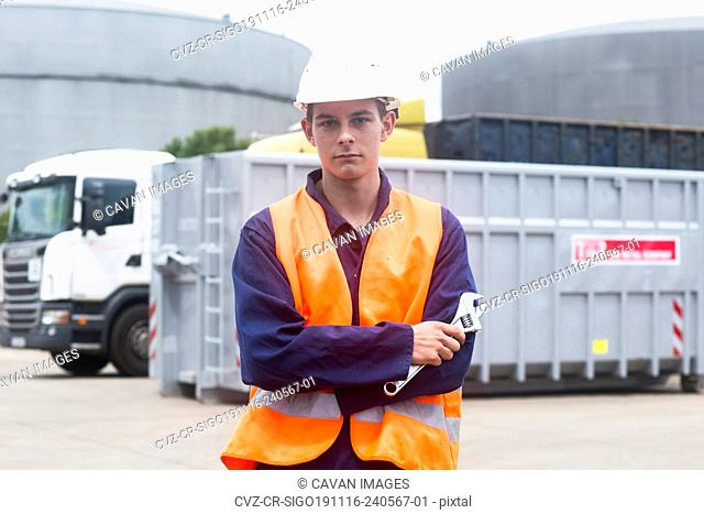 worker young male with helmet outside