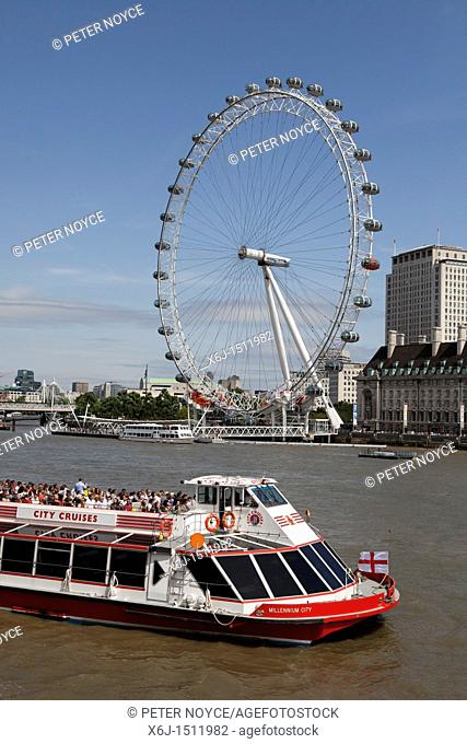 London Eye and a river crusier on the river thames