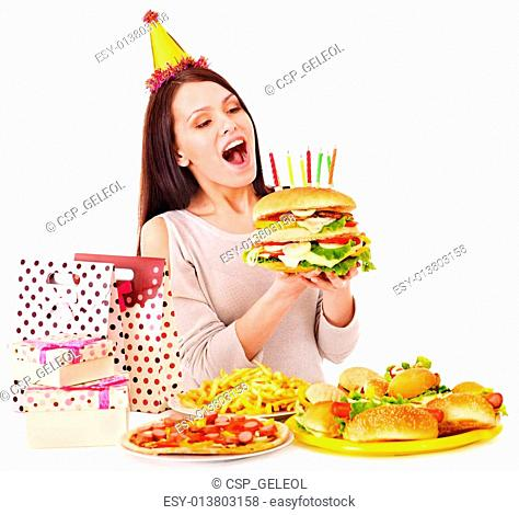 Woman eating hamburger at birthday