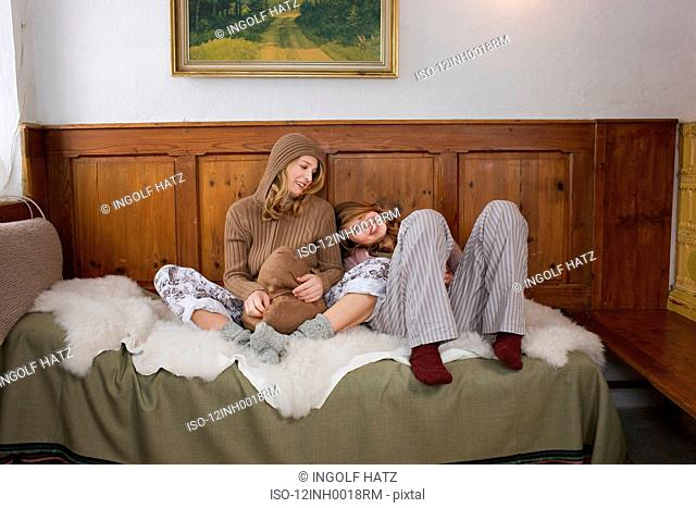 Young women sitting on sofa