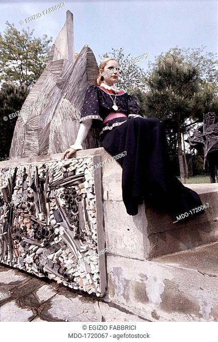 Mia Martini seated near a monument. Italian singer Mia Martini (Domenica Rita Adriana Berté) posing seated beside a monument. 1972