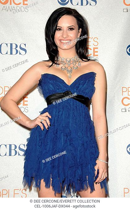 Demi Lovato (wearing a Jenny Packham dress) in the press room for People's Choice Awards 2010 - PRESS ROOM, Nokia Theatre, Los Angeles, CA January 6, 2010