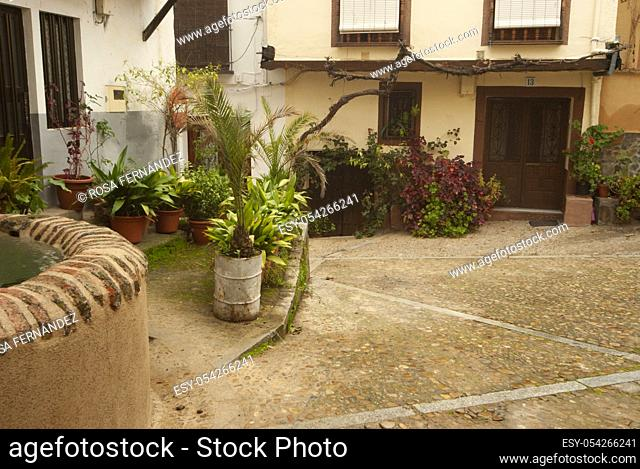 Streets and small squares with traditional plants and gardens, Guadalupe, province of Caceres, Extremadura, Spain