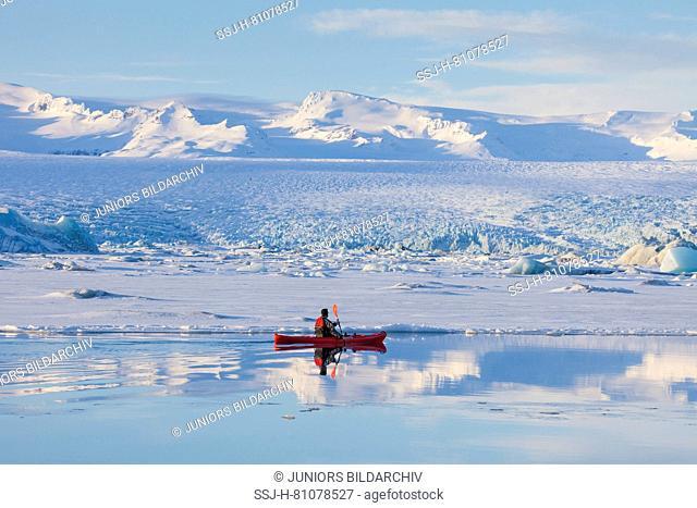 Kayak on the glacial lake Joekusarlon in winter, Iceland